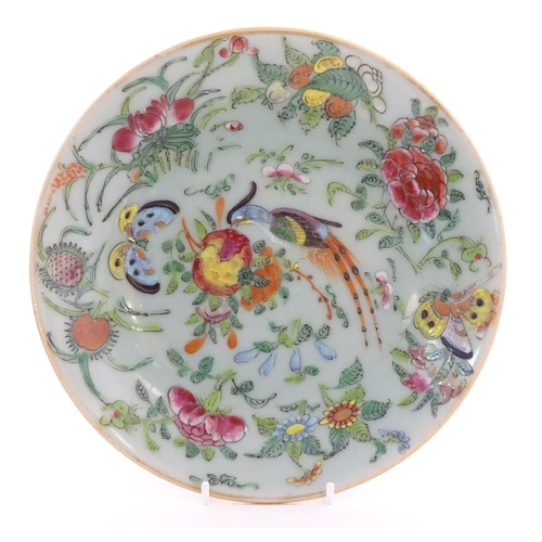 49 - A Chinese celadon style plate decorated with bird, flower and butterfly detail. Character marks unde...