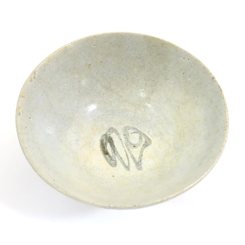 5 - An Oriental earthenware bowl of tapering form with brushwork detail. Approx. 2 1/4