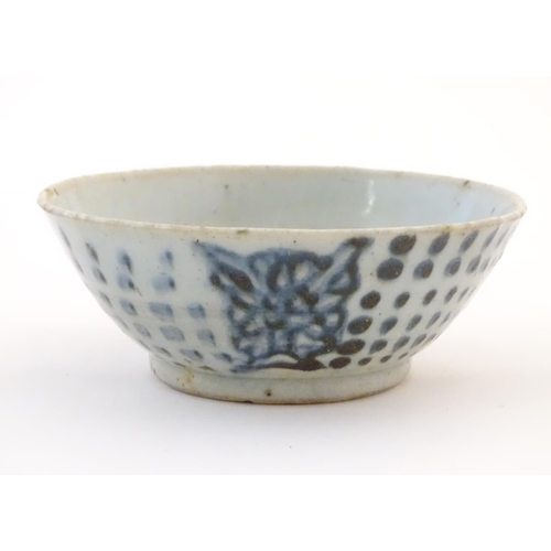 52 - An Oriental earthenware bowl with brushwork detail. Floral motif under. Approx. 2