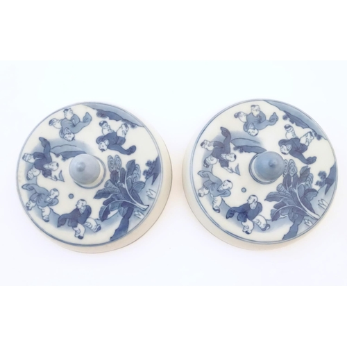 53 - Two Chinese blue and white lids with figures in a landscape. Approx. 6 1/2