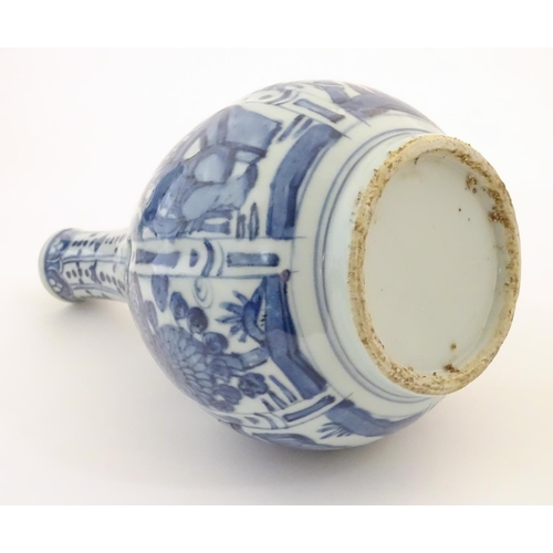 7 - A Chinese blue and white Kraak style bottle vase with panelled decoration depicting figures and gard...