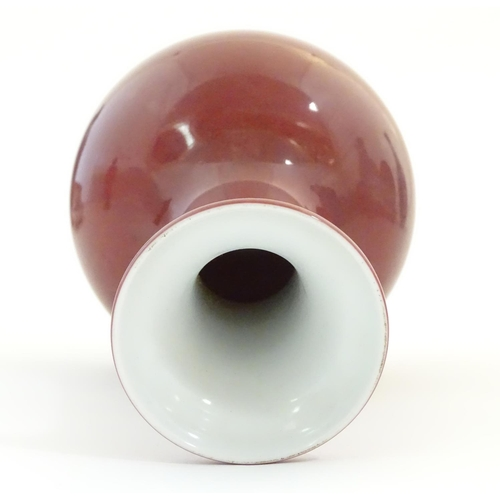 8 - A Chinese bottle vase with a flared rim. Character marks under. Approx. 7 3/4