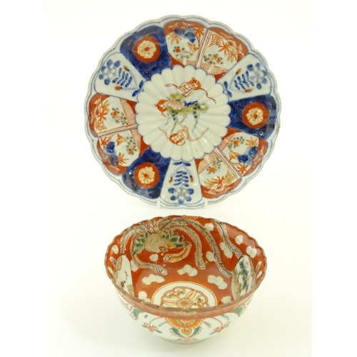 9 - An Oriental plate in the Imari palette decorated with big cat / leopard / cheetah to centre and a bo...