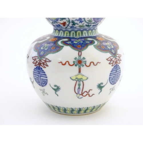 1 - A Chinese double gourd vase with doucai style decoration with scrolling floral and foliate detail. C...