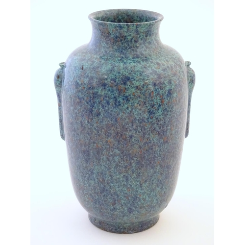 10 - A Chinese vase with moulded twin handles and speckled detail. Impressed character marks under. Appro...