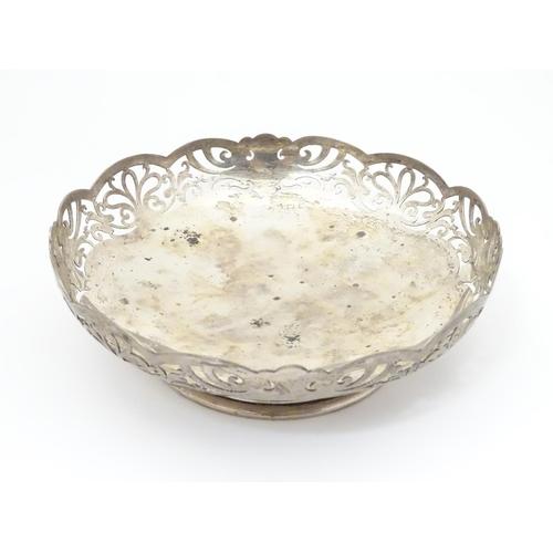 374 - A silver dish with fretwork  decoration hallmarked Birmingham 1944 maker Lanson Ltd . 6 1/2