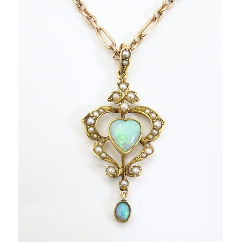 """An Art Nouveau 15ct gold pendant set with opals and seed pearls and a yellow metal chain. Approx. 19"""" long overall"""