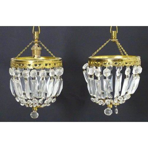 1584 - A pair of 20thC pendant bag chandeliers, the cut glass droplets suspended from gilt mounts. 6
