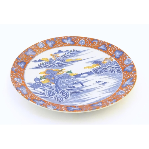 54A - A Japanese charger depicting a mountain landscape scene with a river, boats, a bridge, pagoda style ...
