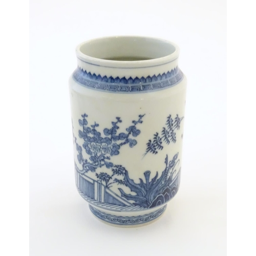 6 - A Chinese blue and white vase of cylindrical form with garden terrace with trees and blossom flowers...