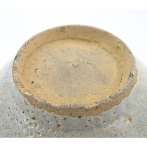 13 - An Oriental earthenware bowl of tapering form with brushwork detail. Approx. 2 1/4