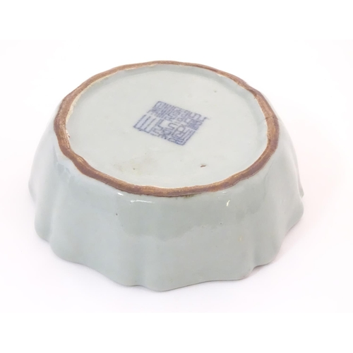 18 - A Chinese celadon brush wash pot with a scalloped edge. Character marks under. Approx. 1 1/2