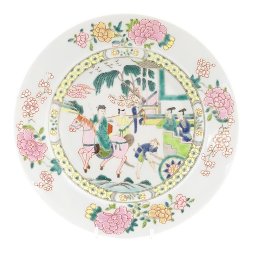 20 - A Chinese famille rose plate depicting a landscape scene with a figure on horse back with an attenda...