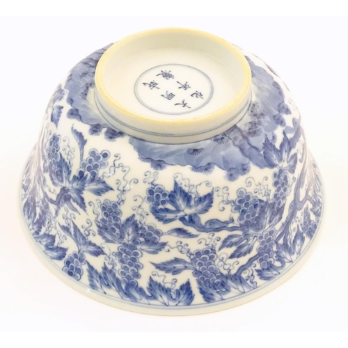 33 - A Chinese blue and white bowl decorated with vine leaves and grapes. Character marks under. Approx. ...