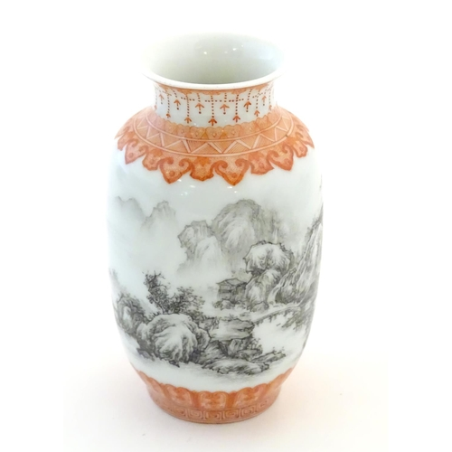 40 - A Chinese small vase with monochrome mountainous landscape detail and orange banded borders. Approx....