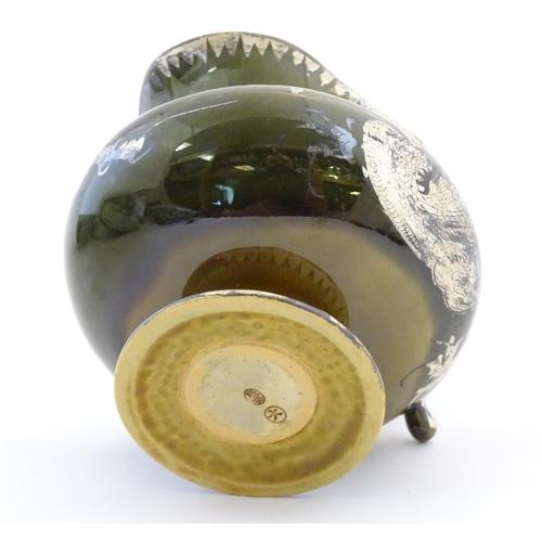 49 - An Oriental pedestal cream jug with gilt dragon detail. Impressed marks under. Approx. 4