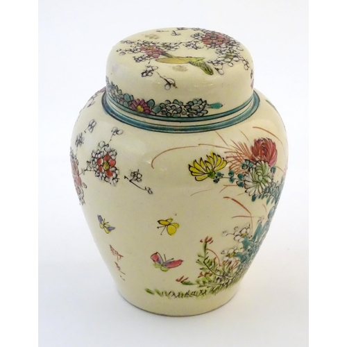 30 - An Oriental ginger jar and cover with inner lid, decorated with flowers and foliage. Possibly Japane...