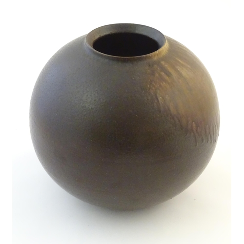 35 - A Japanese vase of globular form with a drip glaze. Approx. 10 3/4