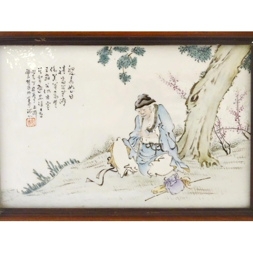 36A - A Chinese porcelain plaque decorated with a seated elder / scholar beneath a tree, with Oriental scr...