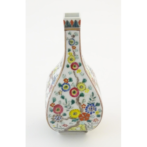 48 - An Oriental vase of squared form decorated with flowers and birds. Possibly Japanese. Character mark...