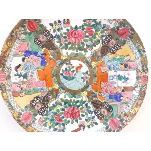 51 - A Chinese / Cantonese plate with panelled decoration depicting flowers, foliage, birds and figures. ...