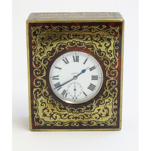 1242 - A Victorian Boulle work Goliath pocket watch case / stand. Together with a Goliath pocket watch. Ret...