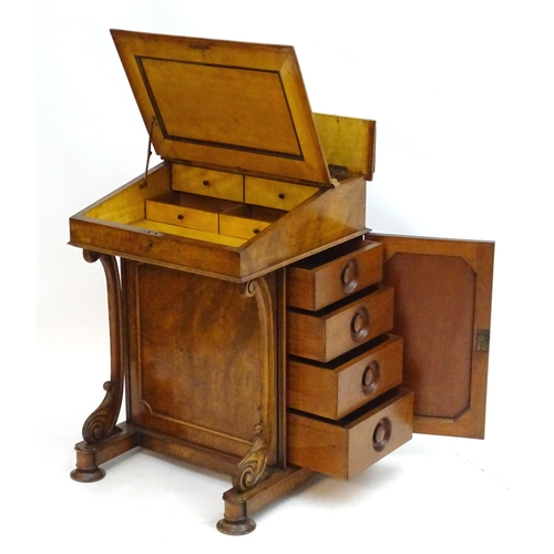 2013 - A 19thC burr walnut Davenport, having a metal pierced gallery above a writing slope opening to show ...
