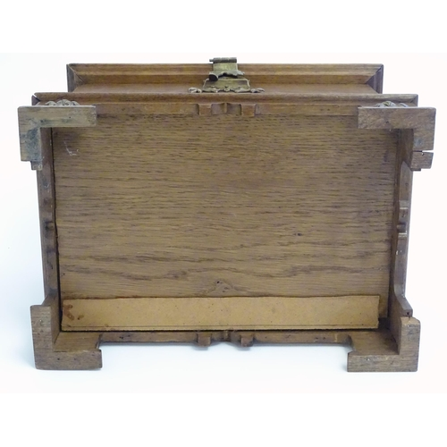 1351 - A late 19th / early 20thC oak table top jewellery box of casket form with brass twin handles, brass ...