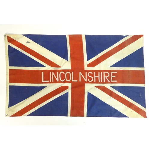 1353 - A mid 20thC Union flag, with applied stencil 'Lincolnshire' , 60
