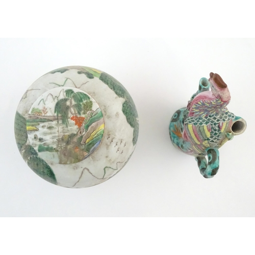 20A - A Chinese ginger jar depicting a wooded river scene with figures on boats, to include men, women, ch...