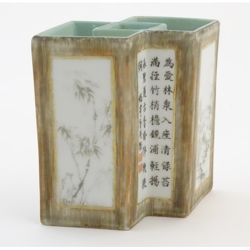 22 - A Chinese brush pot of geometric form, decorated with grisaille landscape scenes, bamboo shoots and ...
