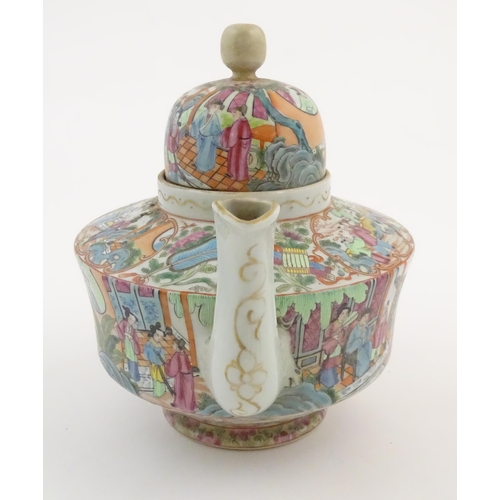 23 - A Chinese famille rose teapot decorated with figures drinking tea, figures on a terrace with fans, c...