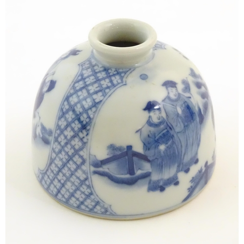 31 - A Chinese blue and white ink pot of dome form decorated with scholars with scrolls in a landscape. C...