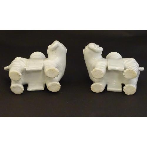 42 - Four Chinese blanc de chine bud vases modelled as elephants. Largest 6 1/2