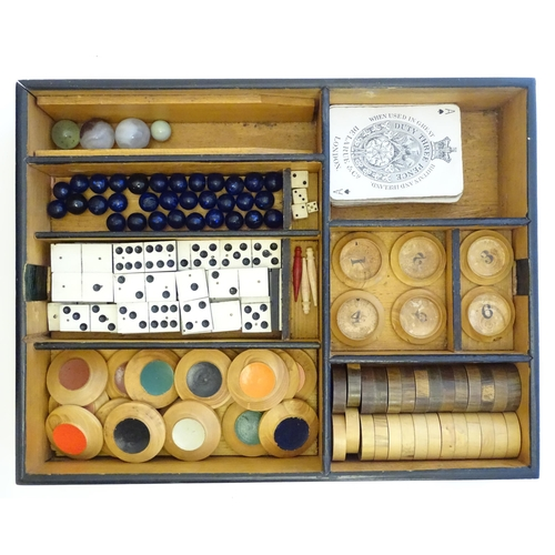 1478 - Toys: A late 19th / early 20thC mahogany games box / compendium with two tier fitted interior contai...