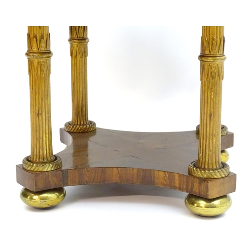 2014 - A Regency rosewood centre table, having an octagonal top with a brass trim to its edge, having four ...
