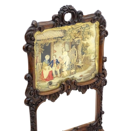 2049 - A pair of William IV rosewood fire screens, having floral carved frames and carrying handles to the ...