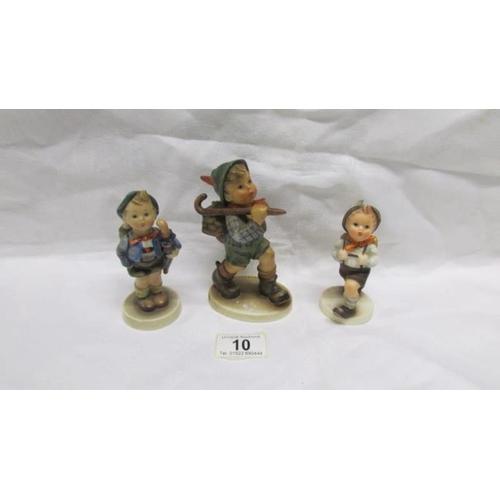 10 - A large Hummel Rambler figure and 2 medium Hummel figures...