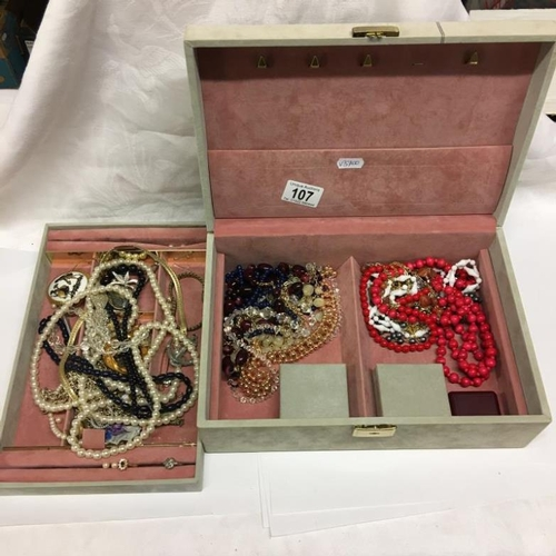 107 - A jewellery box and costume jewellery...