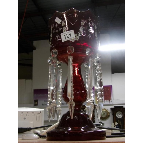 121 - A Victorian ruby glass lustre...