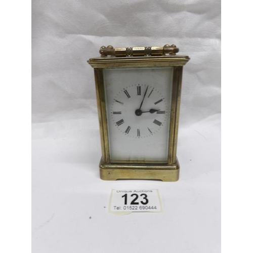 123 - A brass carriage clock...