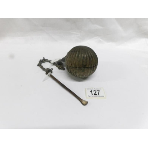 127 - A heavy ball shaped object on chain that opens to reveal a receptacle and with spoon...