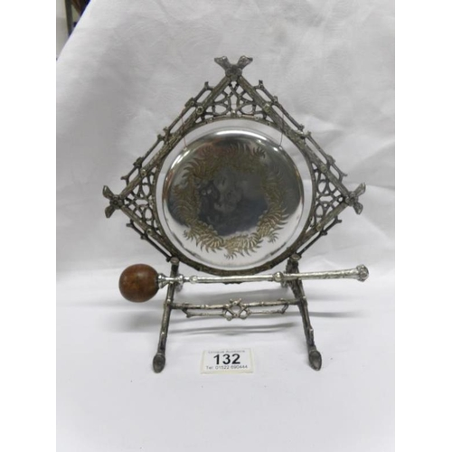 132 - An ornate silver plated table gong...