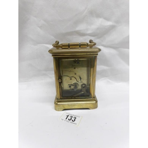 133 - A brass carriage clock (rear glass a/f)...