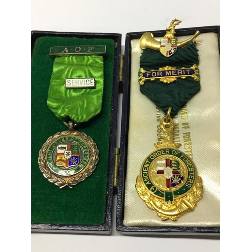 134 - 4 Ancient Order of Foresters official regalia medals, one being silver...