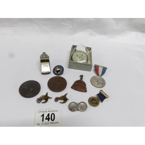 140 - A mixed lot of commemorative medals and badges, vintage pedometer, Acme whistle etc...