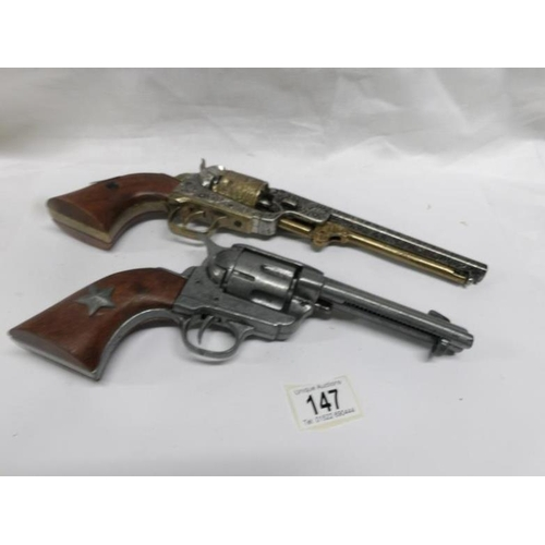 147 - 2 replica ornamental display revolvers...