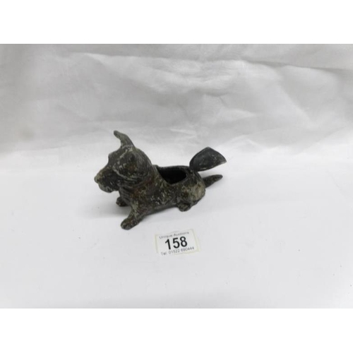 158 - A 1920's painted spelter terrier dog ashtray with hinged back...