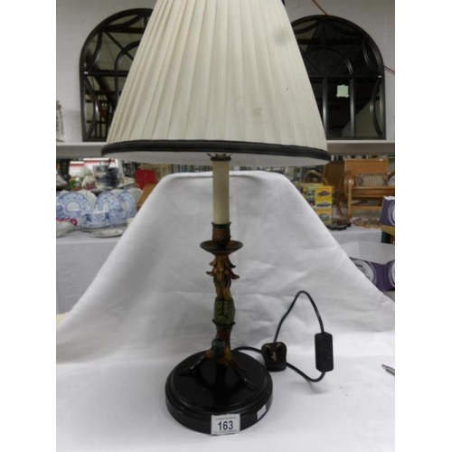 163 - A table lamp being a figure of an Indian doing a handstand, complete with shade...