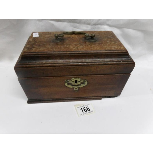 166 - A wooden casket with brass fittings, a/f...